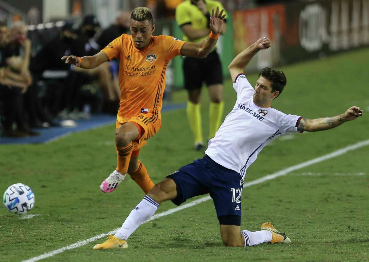 FC Dallas defender Ryan Hollingshead (12) gets the ball out-of-bound from Houston Dynamo midfielder Darwin Ceren (24) during the second half of a MLS match Wednesday, Oct. 7, 2020, at BBVA Stadium in Houston. Houston Dynamo defeated FC Dallas 2-0.