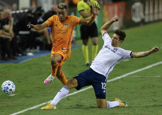 FC Dallas defender Ryan Hollingshead (12) gets the ball out-of-bound from Houston Dynamo midfielder Darwin Ceren (24) during the second half of a MLS match Wednesday, Oct. 7, 2020, at BBVA Stadium in Houston. Houston Dynamo defeated FC Dallas 2-0. Photo: Yi-Chin Lee, Staff Photographer / © 2020 Houston Chronicle