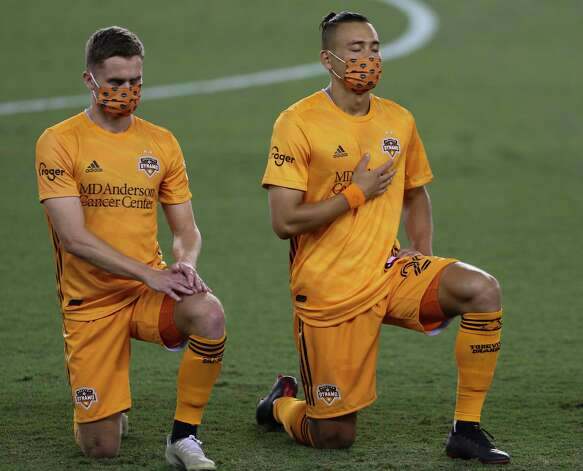 Houston Dynamo players Adam Lundkvist, left, and Sam Junqua kneel during the national anthem at a MLS match against the FC Dallas Wednesday, Oct. 7, 2020, at BBVA Stadium in Houston. Photo: Yi-Chin Lee, Staff Photographer / © 2020 Houston Chronicle