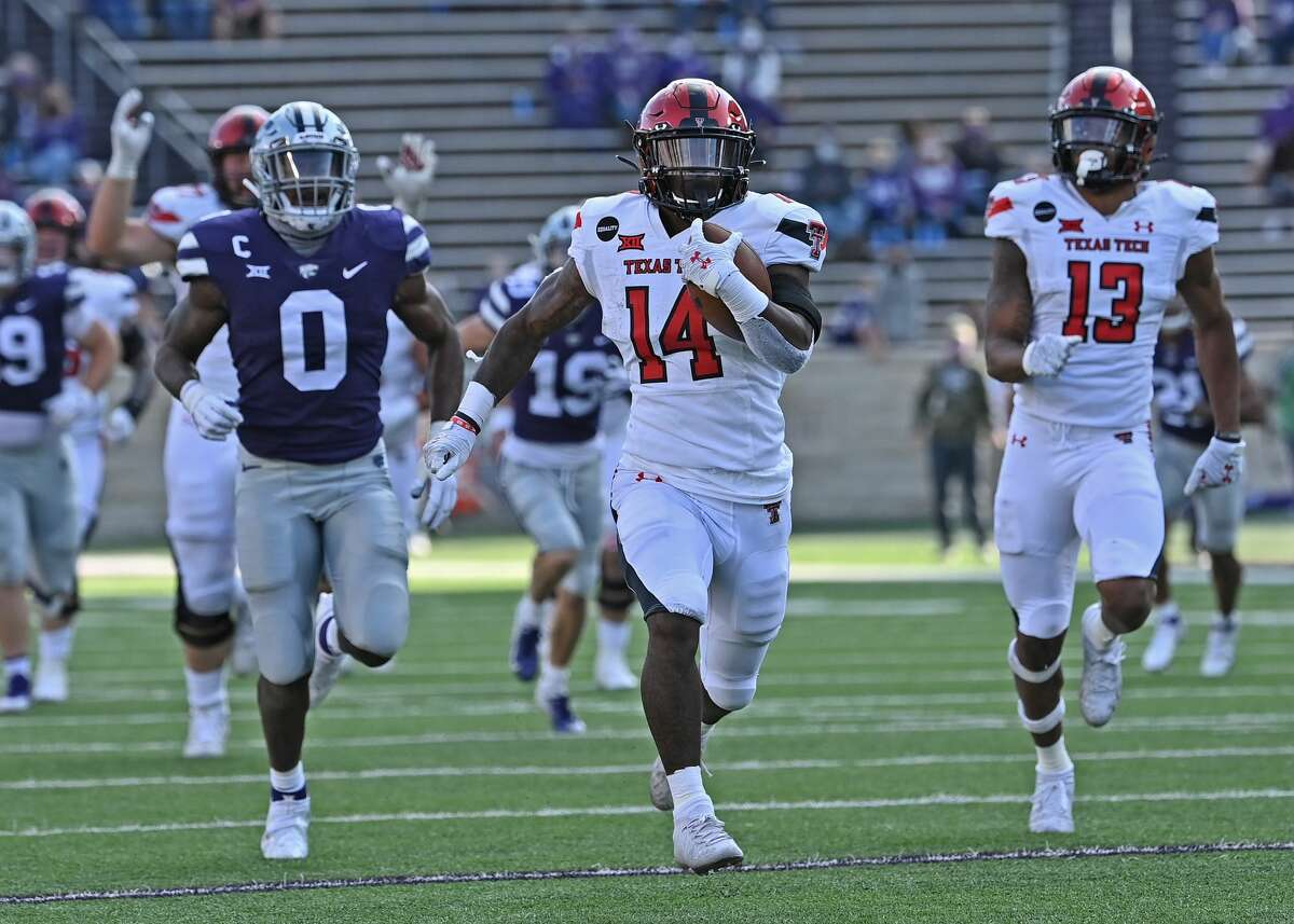MANHATTAN, KS - OCTOBER 03: Running back Xavier White #14 of the Texas Tech Red Raiders rushes down field for a 49 yard touchdown against the Kansas State Wildcats during the second half at Bill Snyder Family Football Stadium on September 3, 2020 in Manhattan, Kansas.