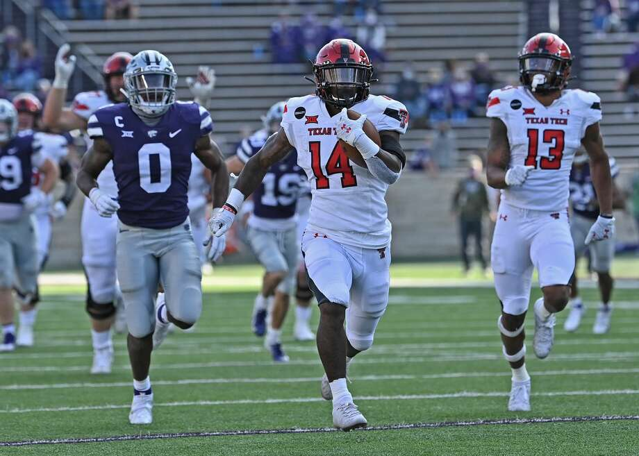 MANHATTAN, KS - OCTOBER 03: Running back Xavier White #14 of the Texas Tech Red Raiders rushes down field for a 49 yard touchdown against the Kansas State Wildcats during the second half at Bill Snyder Family Football Stadium on September 3, 2020 in Manhattan, Kansas. Photo: Peter G. Aiken/Getty Images / 2020 Peter G. Aiken