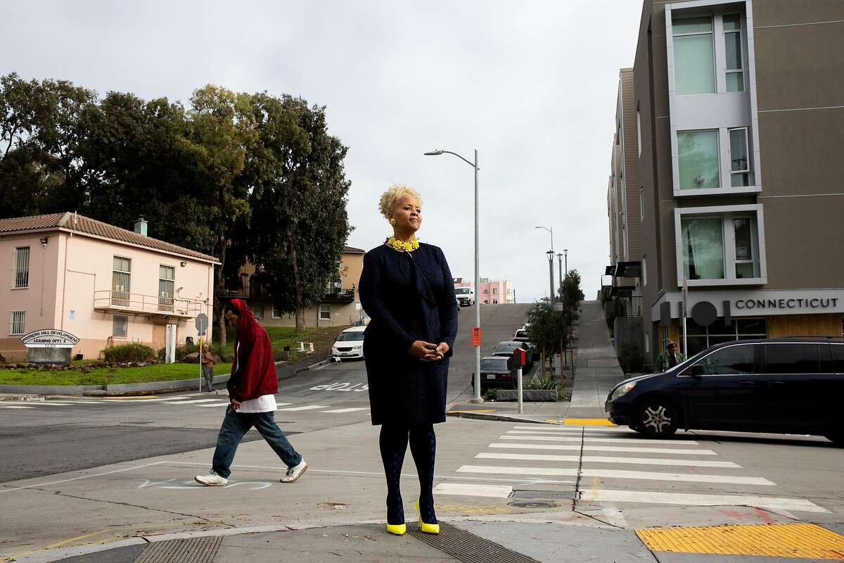 Tonia Lediju, acting director of the Housing Authority, stands outside the Bridge Housing at 1101 Connecticut St. in San Francisco.