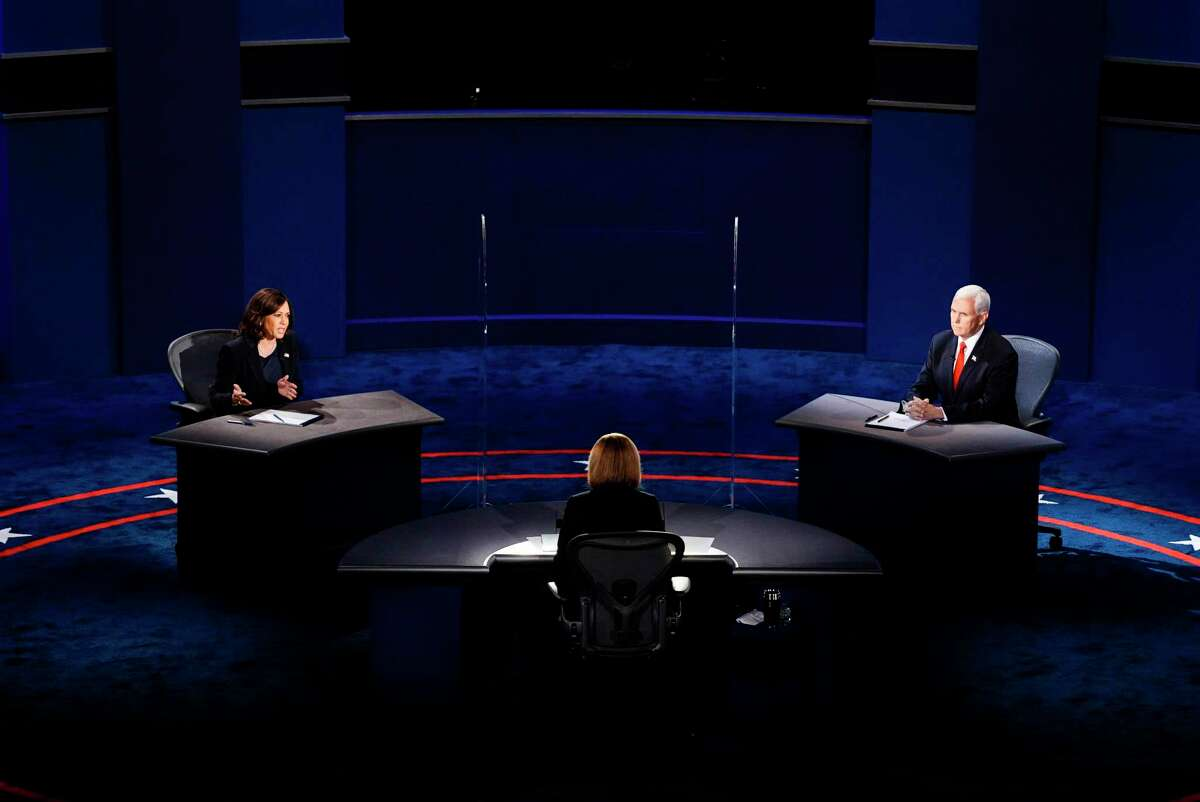 Sen. Kamala Harris, D-Calif., and Vice President Mike Pence participate in the vice-presidential debate at Kingsbury Hall at the University of Utah in Salt Lake City on Wednesday, Oct. 7, 2020.