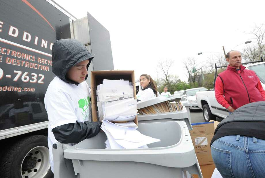 The annual Paper Shredding Day in the Island Beach parking lot in 2017. The event will return on Saturday morning with safety procedures in place. Photo: File / Bob Luckey Jr. / Hearst Connecticut Media / Greenwich Time