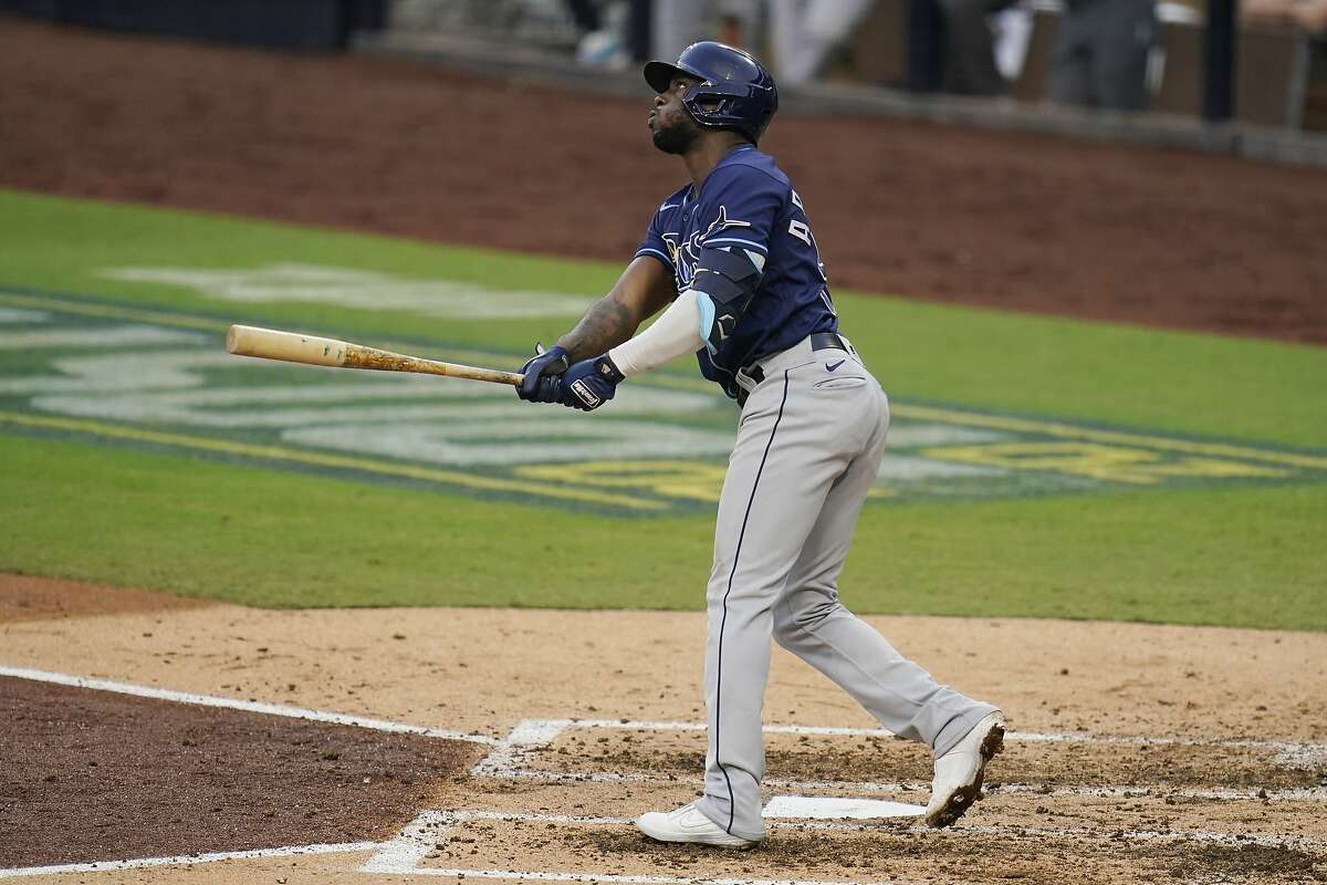 Tampa Bay Rays' Randy Arozarena watches his home run hit against the New York Yankees during the fifth inning in Game 3 of a baseball American League Division Series, Wednesday, Oct. 7, 2020, in San Diego. (AP Photo/Gregory Bull)