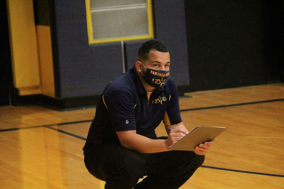 Baldwin volleyball coach Duane Roberts keeps an eye on the action during a home match last week. (Star photo/John Raffel)