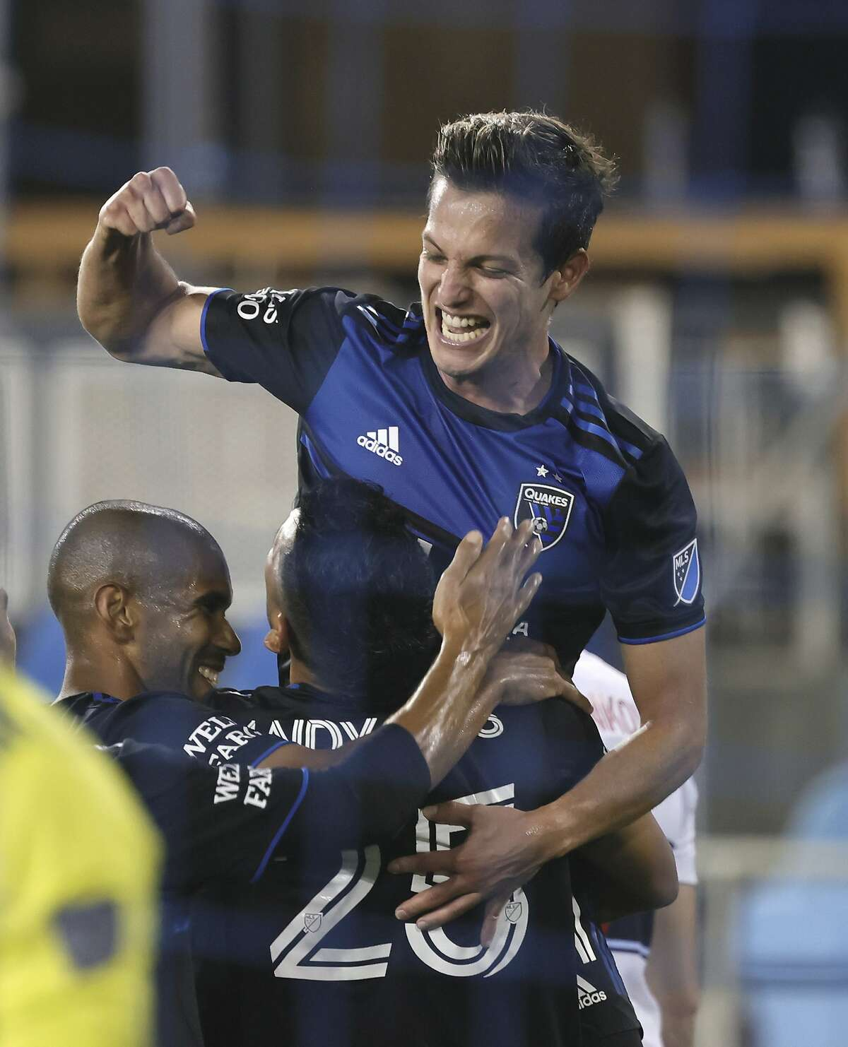 San Jose Earthquakes midfielder Carlos Fierro (21) celebrates after forward Andy Rios, center, scored a goal against the Vancouver Whitecaps during the second half of an MLS soccer match Wednesday, Oct. 7, 2020, in San Jose, Calif. (AP Photo/Josie Lepe)