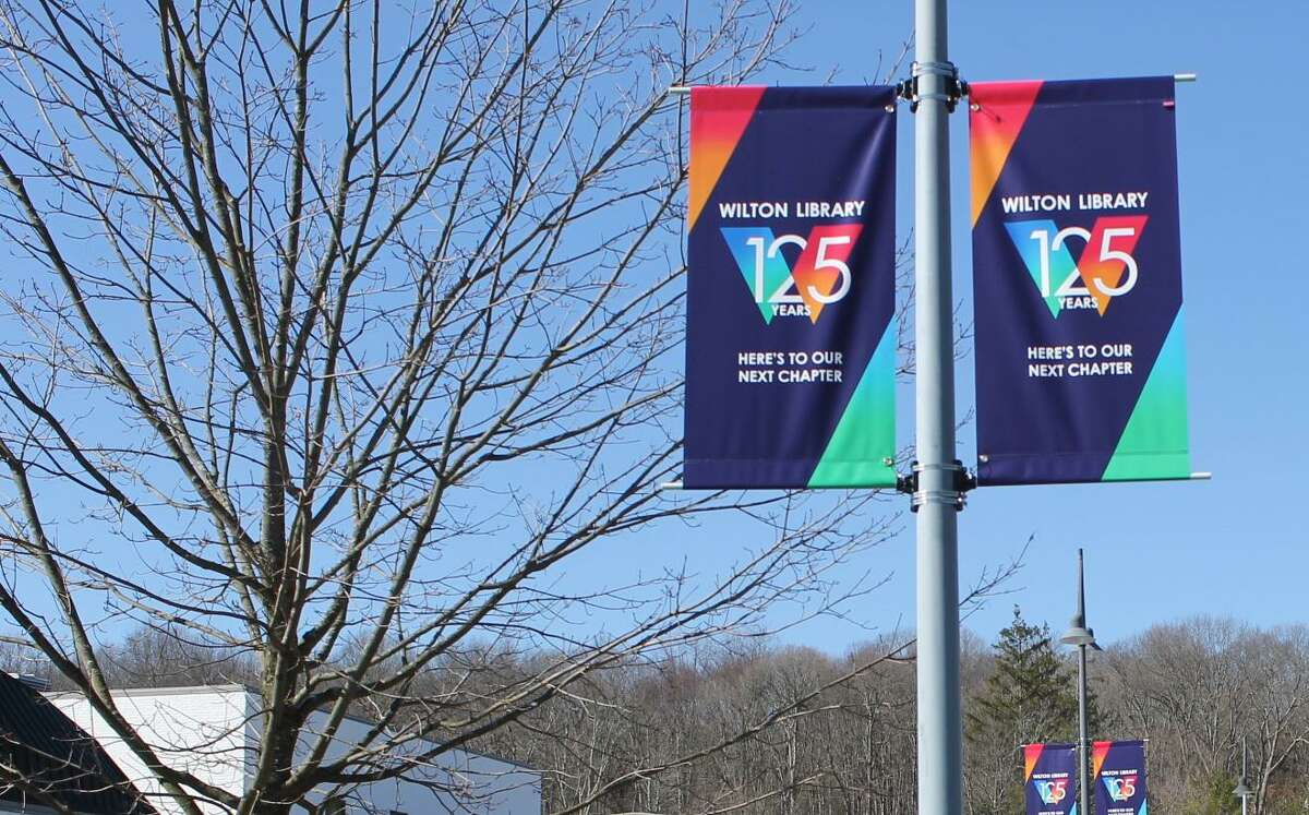 Banners put up earlier this year proclaim Wilton Library's 125th anniversary. What was to be a year of celebration was severely muted by the COVID-19 pandemic.