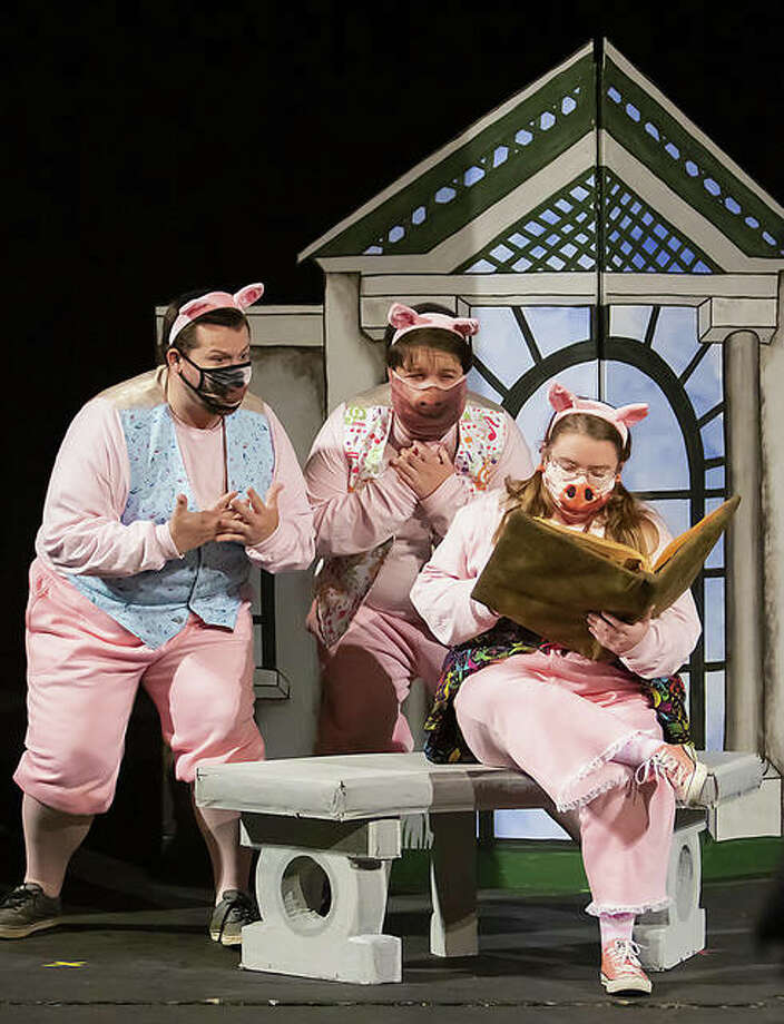 "Southern Illinois University Edwardsville students Xavier Ojeda, Evan Babel and Sarah Collins perform Opera Edwardsville's (OE) ""The Three Little Pigs: An Opera for Kids,"" filmed Oct. 2 at SIUE's Dunham Hall Theater. The set, designed by Roger Speidel, is modeled as the Edwardsville Public Library. OE's ""The Three Little Pigs"" will premiere publicly online for free Friday, Nov. 6, at www.operaedwardsville.org."