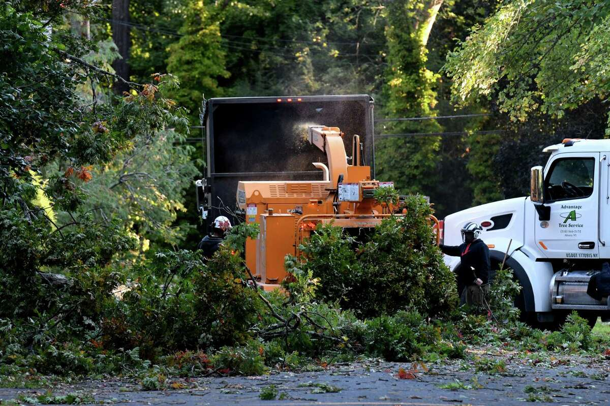 Crews clear fallen trees on Darroch Road on Thursday morning, Oct. 8, 2020, in Delmar, N.Y. High winds from a fast moving storm on Wednesday evening took down trees, collecting utility lines throughout the Capital Region. (Will Waldron/Times Union)