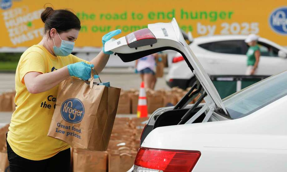 Clara Campbell loads groceries into a car as Community Assistance Center and Interfaith of The Woodlands hosted a mobile food pantry in July for 600 families at Woodforest Bank Stadium in Shenandoah. Three organizations in Montgomery County have received funding to distribute as rental assistance from the Greater Houston COVID-19 Recovery Fund. Photo: Jason Fochtman, Houston Chronicle / Staff Photographer / 2020 © Houston Chronicle