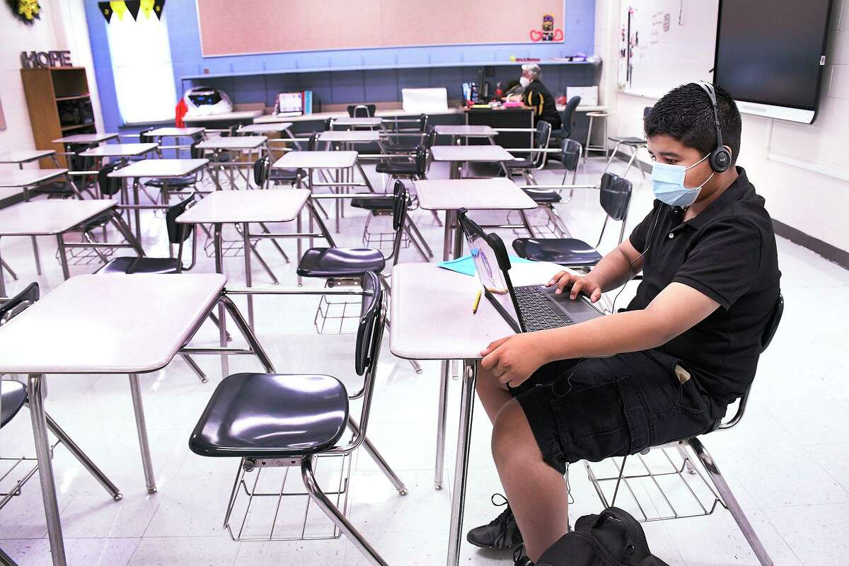 UISD's Salvador Garcia Middle School sixth-grade student Jose Criado Lozano uses his Chromebook to work on a classroom assignment on Aug. 24 as United ISD began their 2020-21 school year.