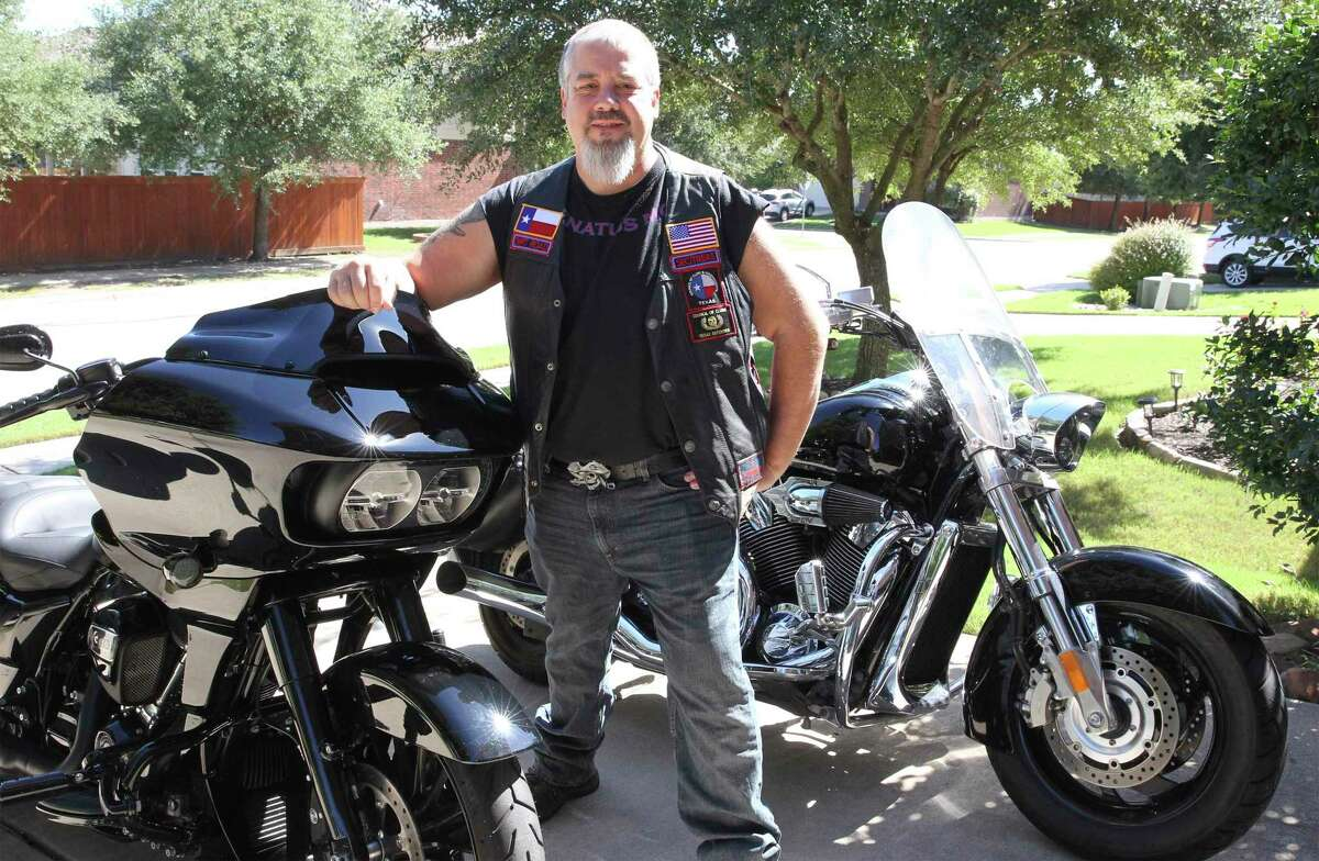 Thomas Kost polishes his motorcycles in the driveway of his home in Pflugerville on Sept. 29, 2020.