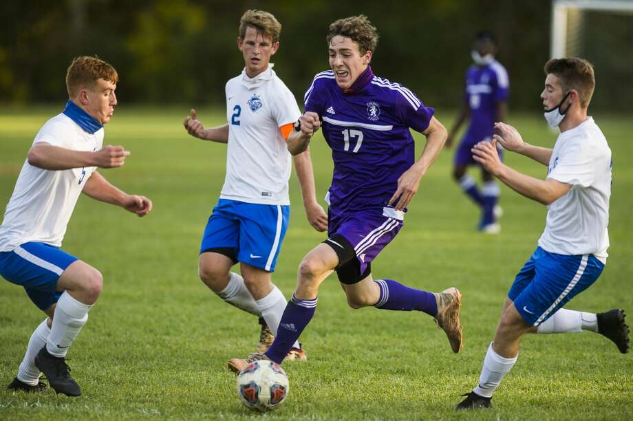 CBA's Toby Stauffer brings the ball upfield during an Oct. 6, 2020 game against Genesee Christian. Photo: Daily News File Photo