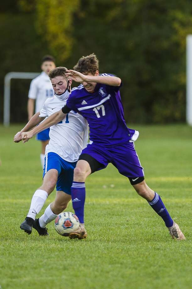 CBA's Toby Stauffer (right) battles for the ball during an Oct. 6, 2020 game against Genesee Christian. Photo: Daily News File Photo