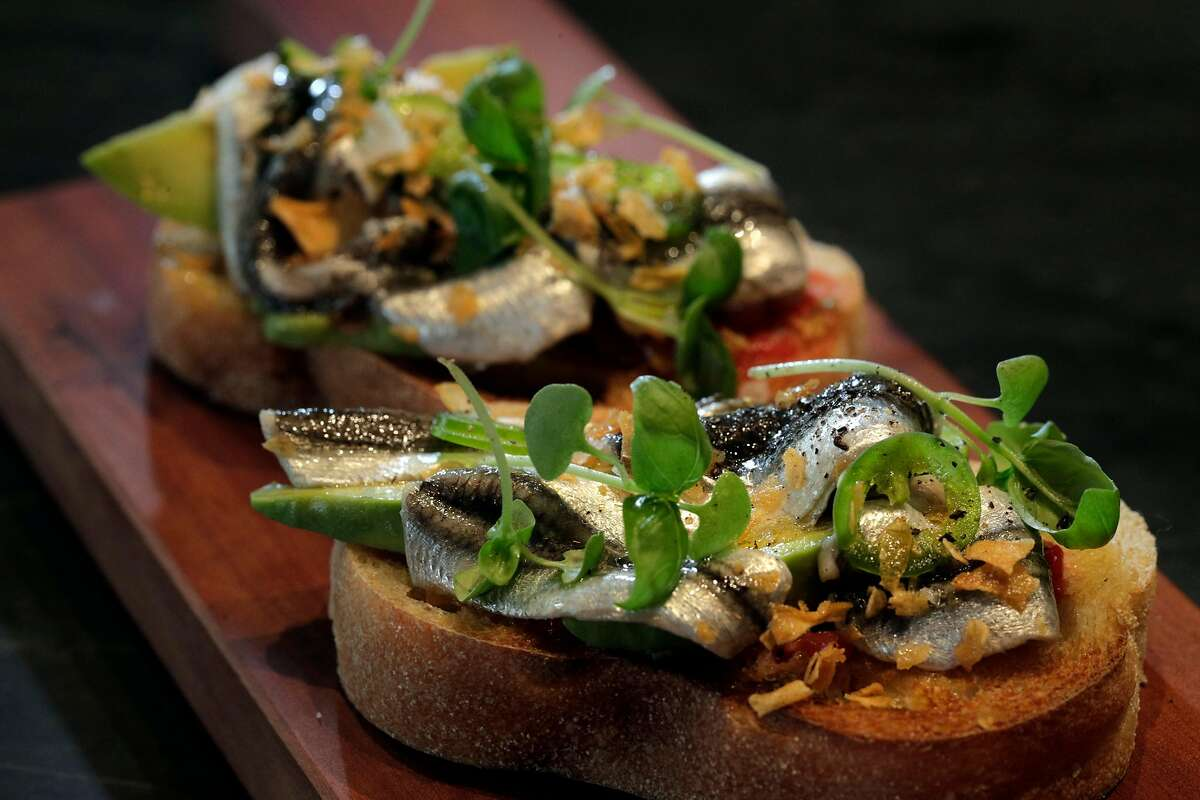 Local boquerones, fresh white anchovies served on avocado toast, will be available for two more weeks at the Anchovy Bar.