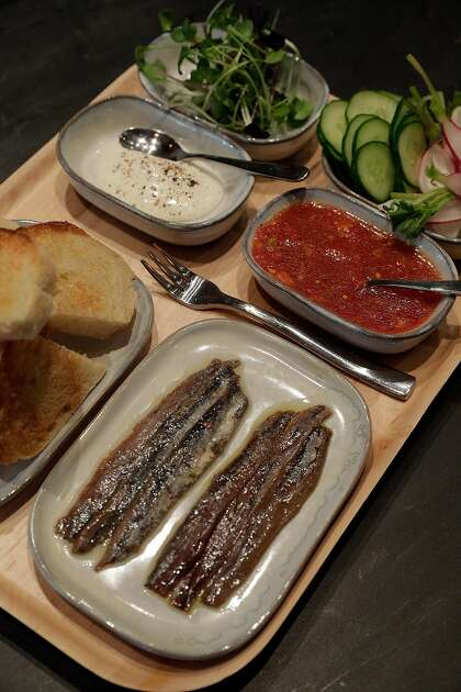 Diners are encouraged to make their own anchovy toasts at San Francisco's Anchovy Bar.