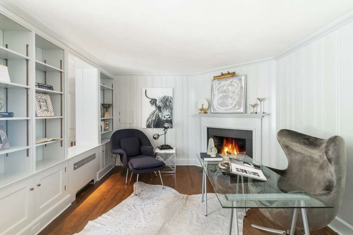 In addition to the spacious public rooms, the home also has some more intimate spaces, as well, including a first-floor library and a second-floor home office. It's a very workable kitchen, with a nice triangle between the stove, the sink and the refrigerator,