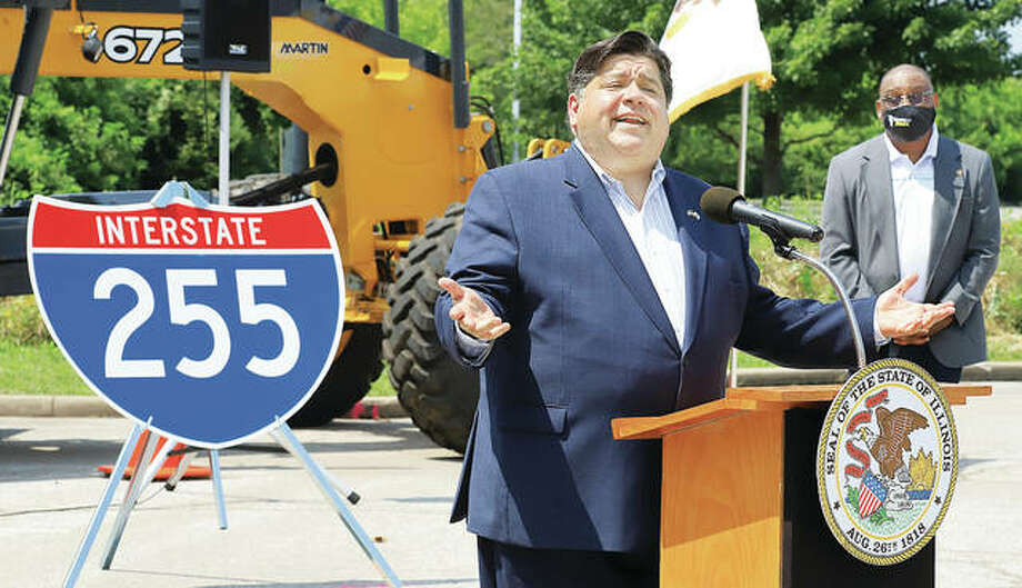 In this July photo, Gov. J.B. Pritzker answers questions from the press at the Illinois Department of Transportation offices in Collinsville. IDOT currently is nearing completion of the Interstate 255 project and is planning seven other Metro East projects next year.