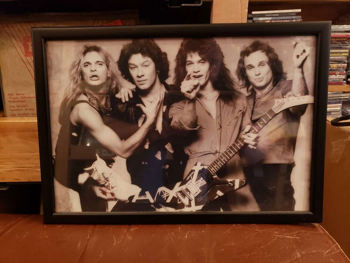 A publicity photo that is displayed in Darien's Johnny's Records. On Wednesday, owner John Conrad shared his thoughts and reflections on the career of Eddie Van Halen, who died Tuesday at the age of 65.