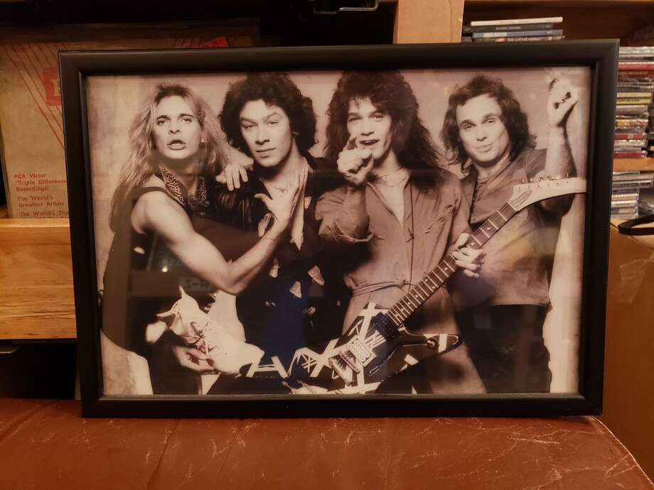 A publicity photo that is displayed in Darien's Johnny's Records. On Wednesday, owner John Conrad shared his thoughts and reflections on the career of Eddie Van Halen, who died Tuesday at the age of 65. Photo: John Conrad
