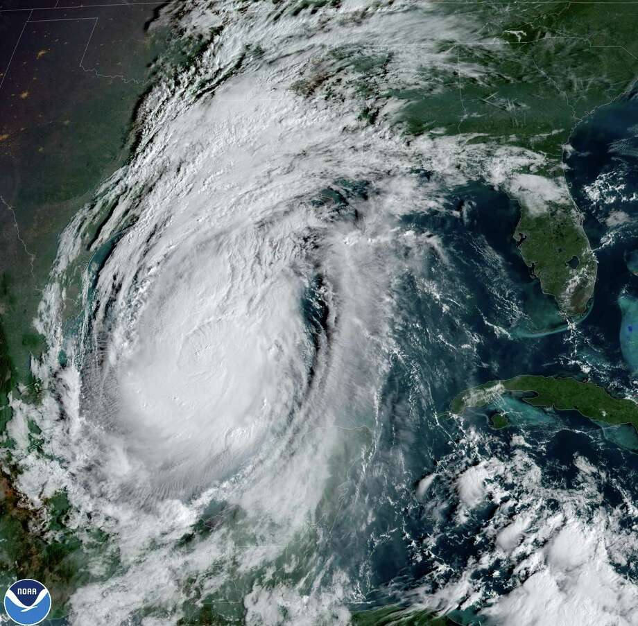 """This National Oceanic and Atmospheric Administration satellite image shows Hurricane Delta moving towards the US on October 8, 2020, at 13:41UTC. - Delta regained strength as it headed towards the US early on October 8, 2020, after lashing Mexico's Caribbean coast, where some tourists complained about conditions in crowded emergency shelters during a pandemic. In an update at 0600 GMT Thursday, the US National Hurricane Center (NHC) said Delta was packing maximum sustained winds of 100 miles (155 kilometers) per hour and moving at about 17 mph (28 kph) about 485 miles (780 kms) off the coast of Louisiana. (Photo by Handout / NOAA/GOES / AFP) / RESTRICTED TO EDITORIAL USE - MANDATORY CREDIT """"AFP PHOTO / NOAA/GOES"""" - NO MARKETING - NO ADVERTISING CAMPAIGNS - DISTRIBUTED AS A SERVICE TO CLIENTS (Photo by HANDOUT/NOAA/GOES/AFP via Getty Images) Photo: HANDOUT, Contributor / NOAA/GOES/AFP Via Getty Images / AFP or licensors"""