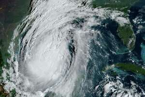 """This National Oceanic and Atmospheric Administration satellite image shows Hurricane Delta moving towards the US on October 8, 2020, at 13:41UTC. - Delta regained strength as it headed towards the US early on October 8, 2020, after lashing Mexico's Caribbean coast, where some tourists complained about conditions in crowded emergency shelters during a pandemic. In an update at 0600 GMT Thursday, the US National Hurricane Center (NHC) said Delta was packing maximum sustained winds of 100 miles (155 kilometers) per hour and moving at about 17 mph (28 kph) about 485 miles (780 kms) off the coast of Louisiana. (Photo by Handout / NOAA/GOES / AFP) / RESTRICTED TO EDITORIAL USE - MANDATORY CREDIT """"AFP PHOTO / NOAA/GOES"""" - NO MARKETING - NO ADVERTISING CAMPAIGNS - DISTRIBUTED AS A SERVICE TO CLIENTS (Photo by HANDOUT/NOAA/GOES/AFP via Getty Images)"""