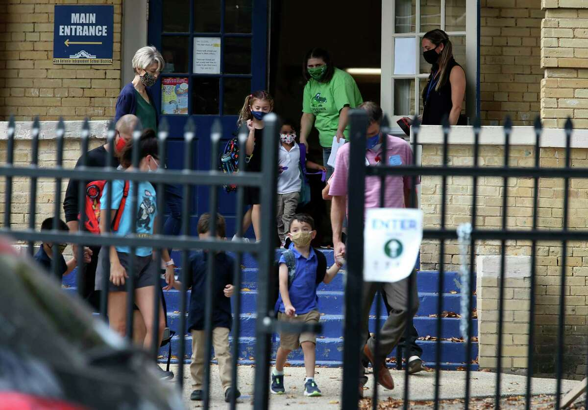 Children are released at the end of the school day at SAISD's Advanced Learning Academy at Euclid last October. With COVID-19 metrics prompting Metro Health to change its risk level from severe to moderate, the district is encouraging an increase in the number of students in its classrooms.