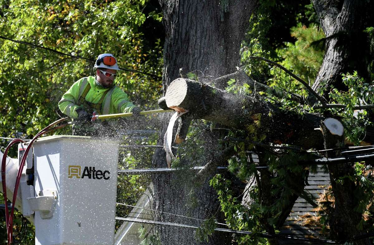 Work crews clear fallen tree limbs from utility lines along Hawthorne Avenue on Thursday, Oct. 8, 2020, in Delmar, N.Y. Strong winds from a fast moving storm on Wednesday evening took down trees caused damage throughout the Capital Region. (Will Waldron/Times Union)
