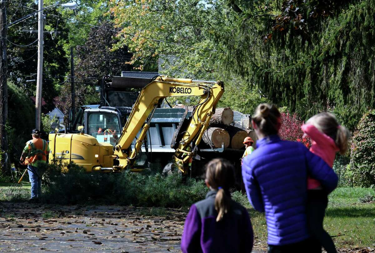 Neighbors watch as a Bethlehem work crew clears a fallen tree from Pinedale Avenue on Thursday, Oct. 8, 2020, in Delmar, N.Y. Strong winds from a fast moving storm on Wednesday evening took down trees caused damage throughout the Capital Region. (Will Waldron/Times Union)