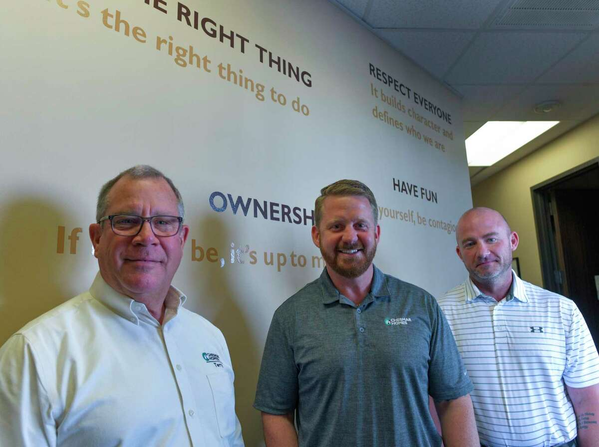 Terry Jermolajevs, left, Ken Glass and Will Sherman help make Chesmar Homes one of the San Antonio Express-News Top Workplaces for 2020.