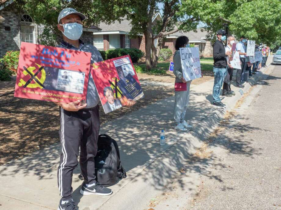 Chinese activists line both sides of the street on Bishop Castle Dr. outside Bob Fu's home in Midland 10/08/2020. Tim Fischer/Reporter-Telegram Photo: Tim Fischer, Midland Reporter-Telegram