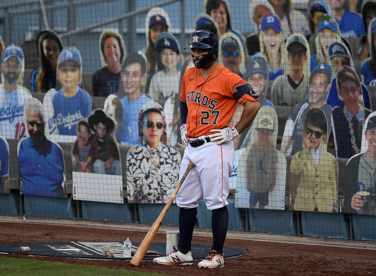 Jose Altuve #27 of the Houston Astros looks on from the on deck circle during the ninth inning against the Oakland Athletics in Game Three of the American League Division Series at Dodger Stadium on October 07, 2020 in Los Angeles, California.