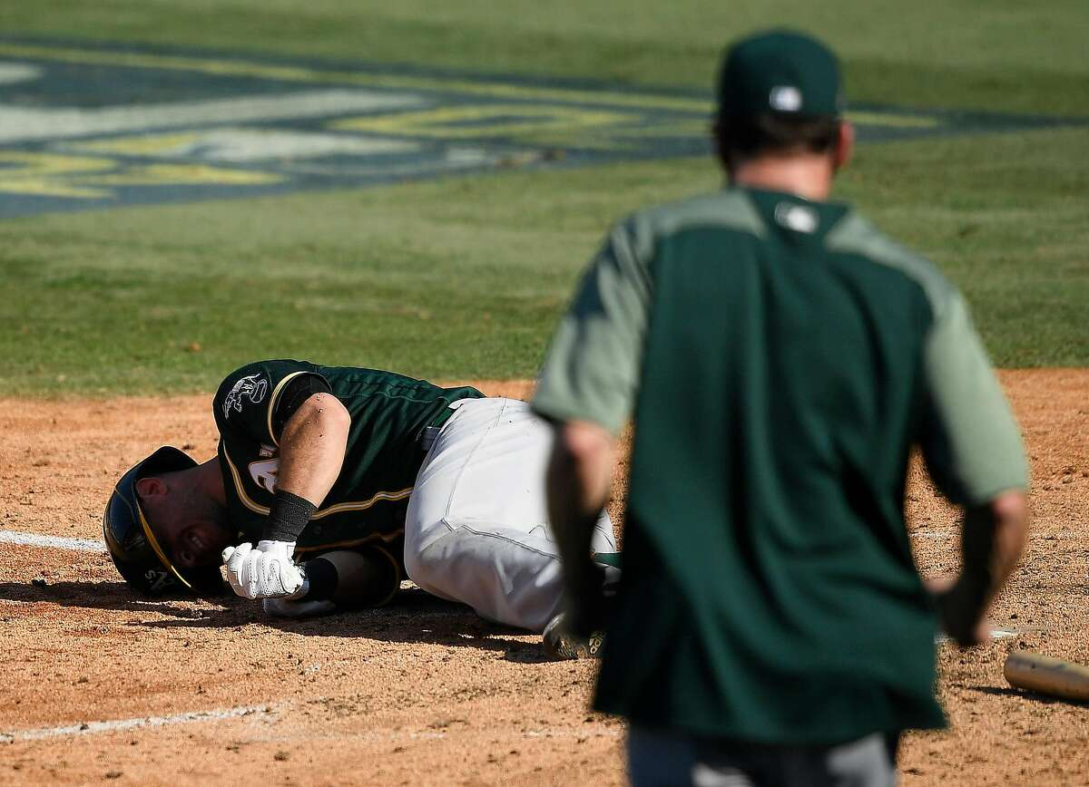 Tommy La Stella #3 of the Oakland Athletics reacts after being hit by a pitch by Brooks Raley #58 of the Houston Astros during the eighth inning in Game Three of the American League Division Series at Dodger Stadium on October 07, 2020 in Los Angeles, California.