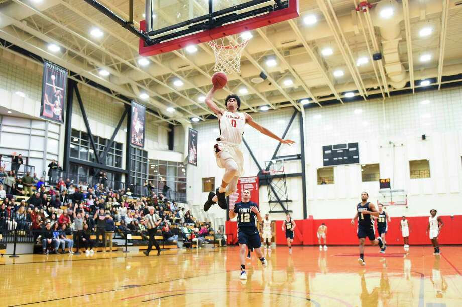 Wesleyan basketball player Austin Hutcherson dunking during a home game. Photo: Steve McLaughlin / Contributed Photo Via Wesleyan Athletics
