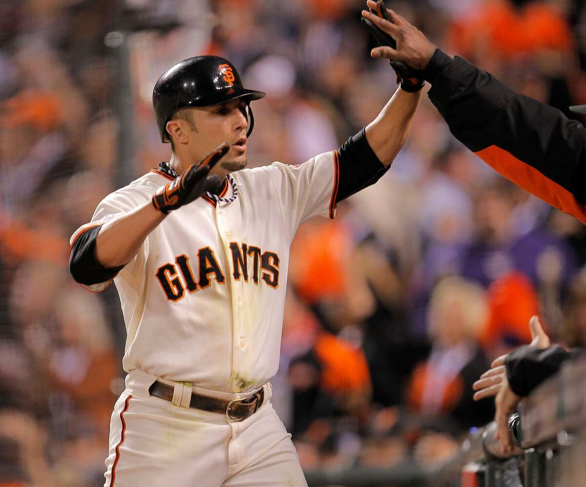 Andres Torres celebrates after scoring on a Freddy Sanchez double in the fifth inning to give the Giants a lead they would not relinquish in an 11-7 victory over the Texas Rangers in Game 1 of the 2010 World Series.