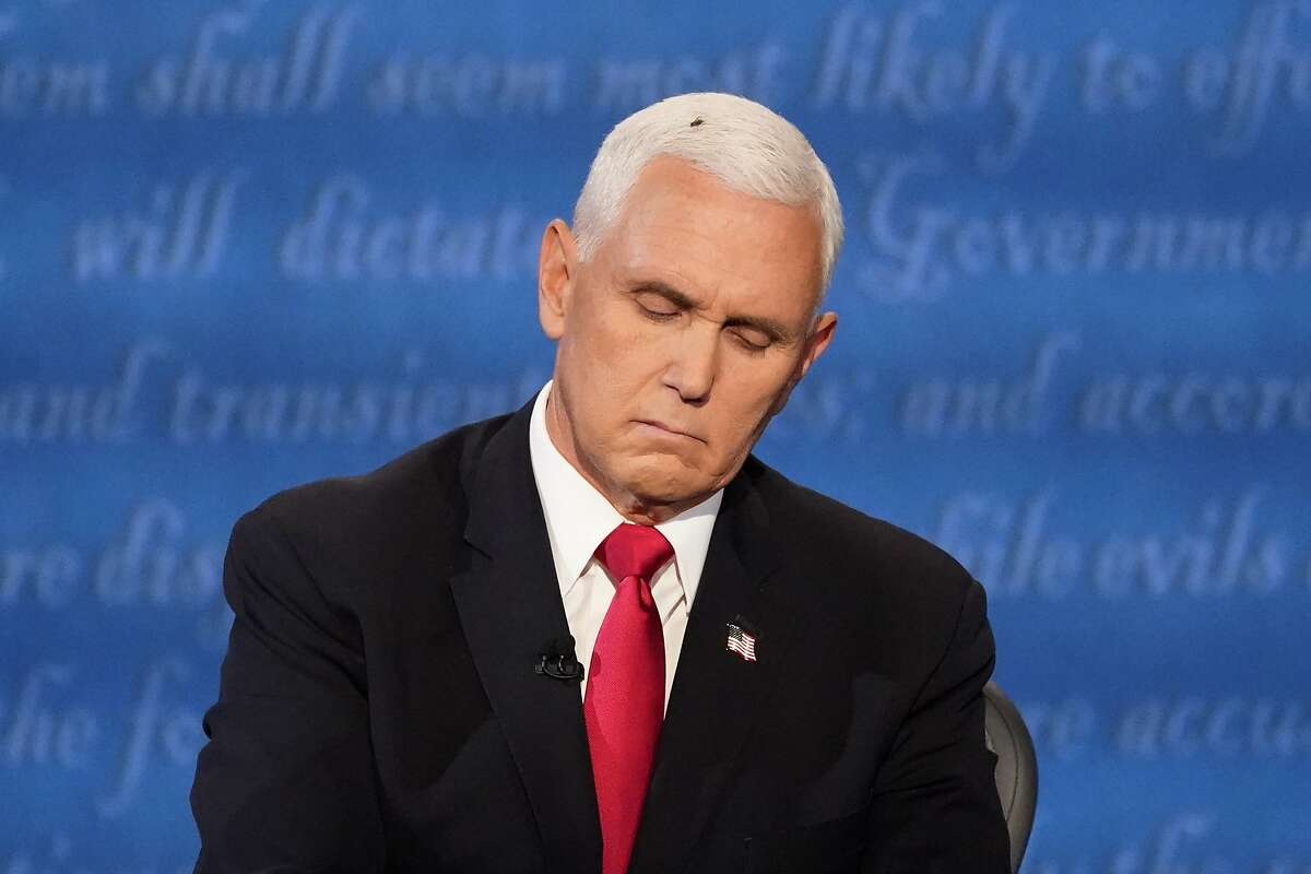 Vice President Mike Pence listens to Democratic vice presidential candidate Sen. Kamala Harris, D-Calif., during the vice presidential debate Wednesday, Oct. 7, 2020, at Kingsbury Hall on the campus of the University of Utah in Salt Lake City.
