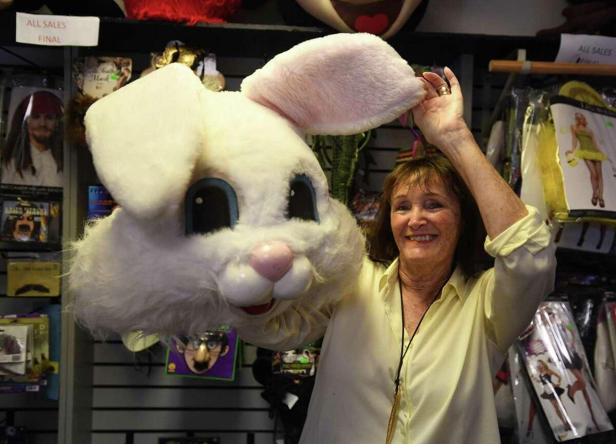 Eileen Petrillo with a rental rabbit costume at Characters & Costumes in Guilford.