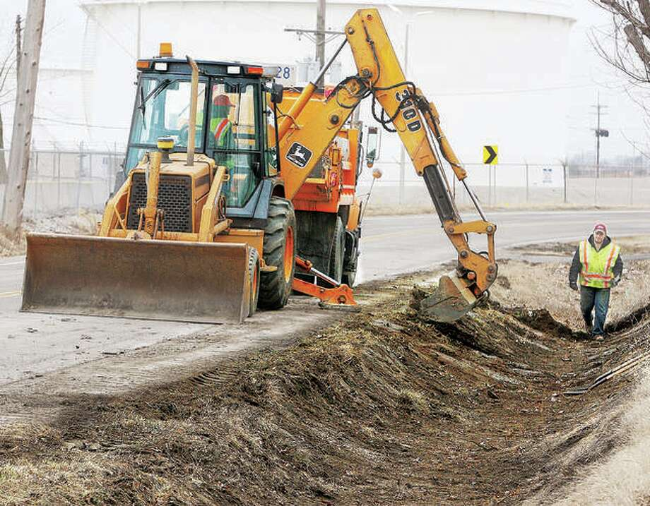 In this February 2015 file photo, workers from the Illinois Department of Transportation dig out the drainage ditches that run on both sides of Old Edwardsville Road through Roxana this week. IDOT will hold a virtual public meeting Oct. 27 for the I-270 Preliminary Engineering Study from Riverview Drive Interchange in Missouri to Route 157 in Madison County. Photo: John Badman   Hearst Newspapers