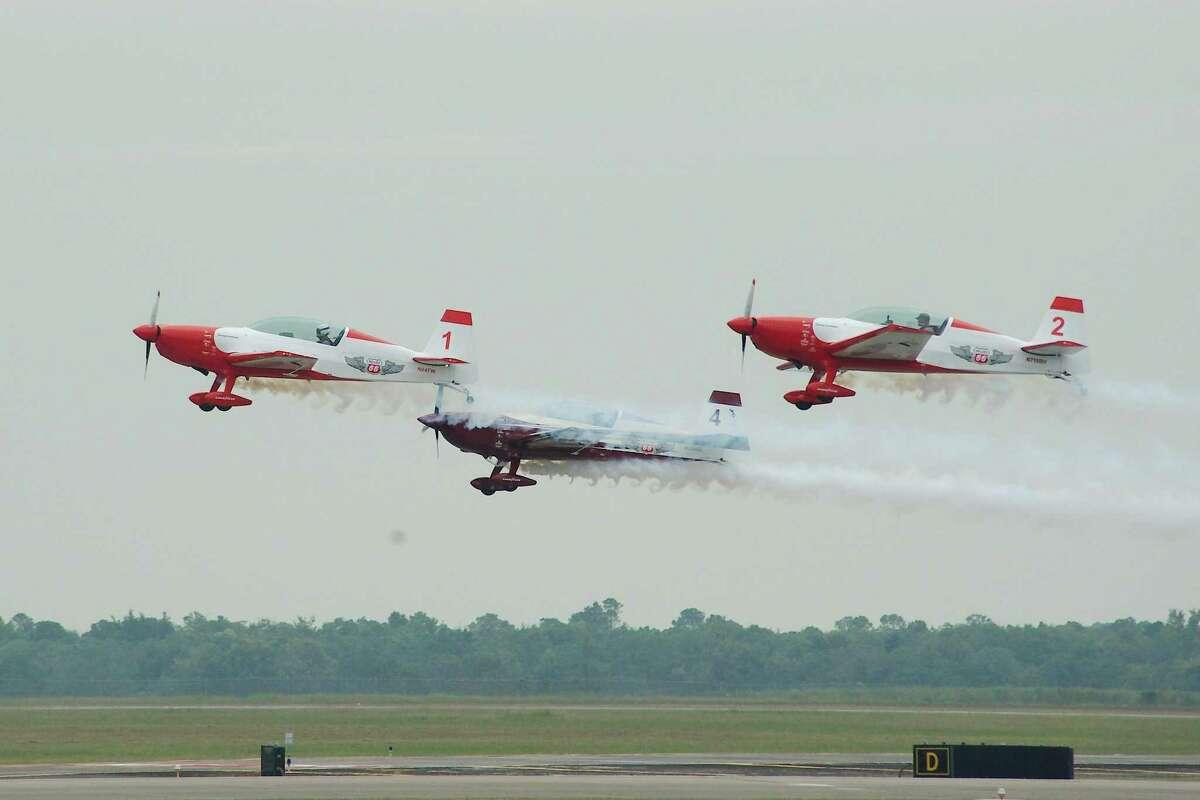 The Phillips 66 Aerostars acrobatic team performs over Ellington.