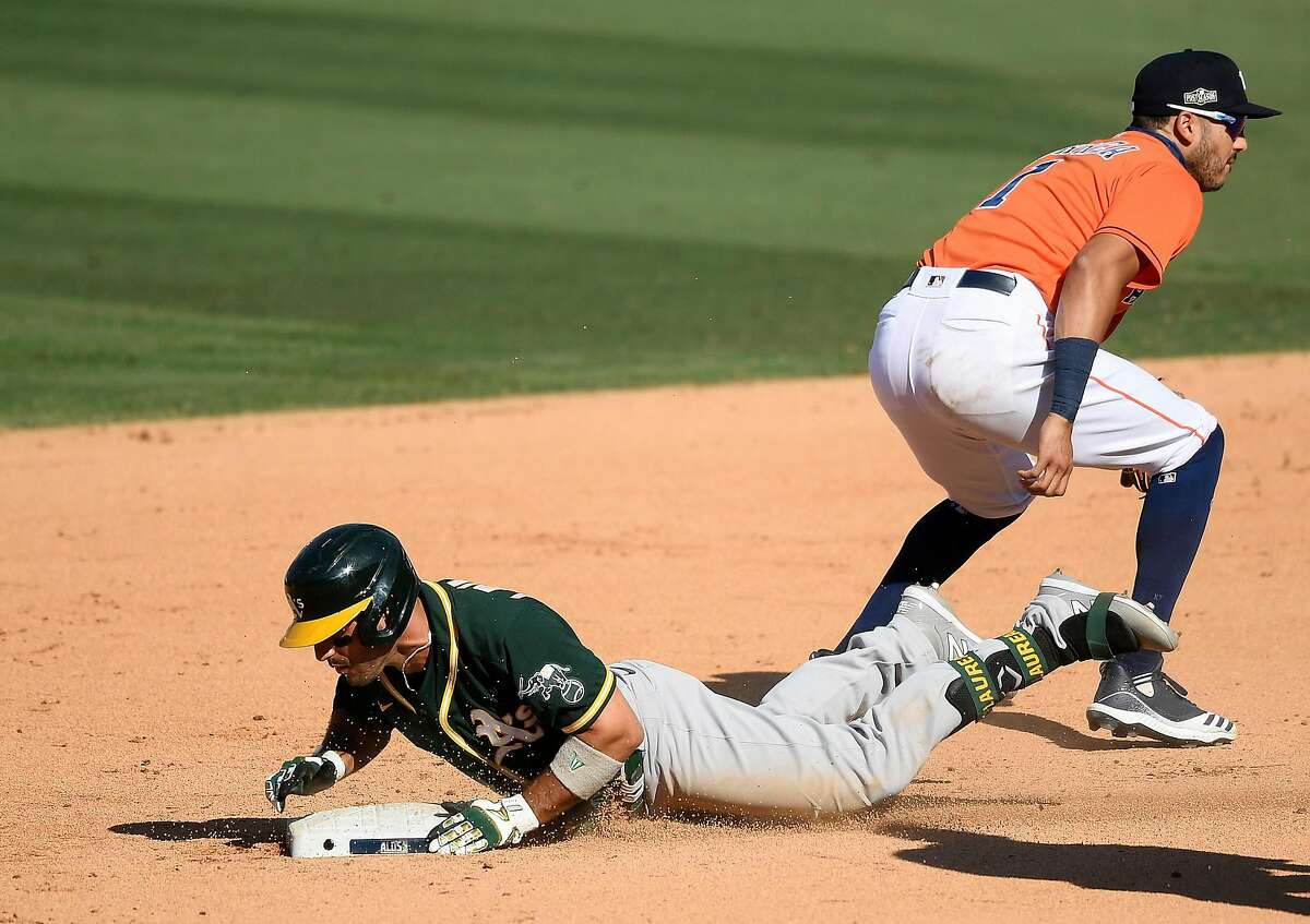 Ramon Laureano #22 of the Oakland Athletics slides safe into second base on a double against the Houston Astros during the eighth inning in Game Three of the American League Division Series at Dodger Stadium on October 07, 2020 in Los Angeles, California.