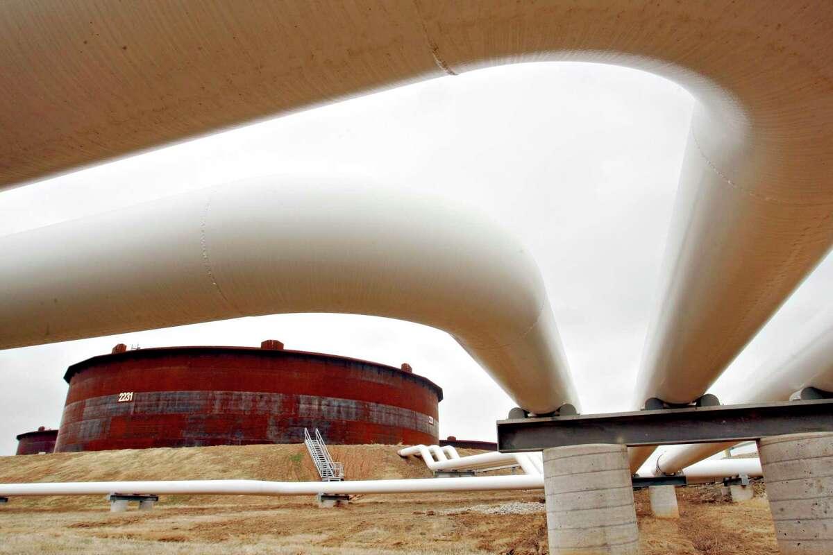 Oil pipelines feed into 575,000-barrel capacity storage tanks at the Enbridge Inc. Cushing Terminal in Cushing, Okla.