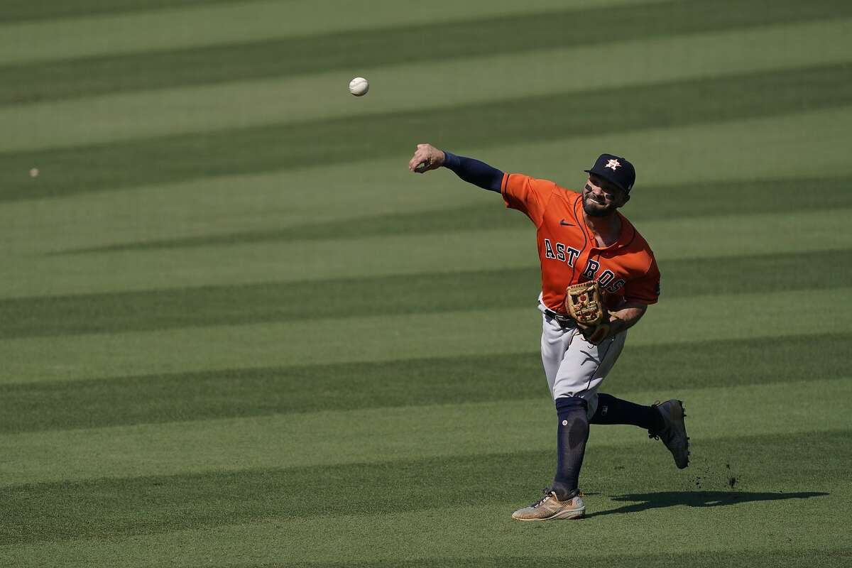 Houston Astros second baseman Jose Altuve throws the ball to the infield during Game 2 of a baseball American League Division Series against the Oakland Athletics in Los Angeles, Tuesday, Oct. 6, 2020.