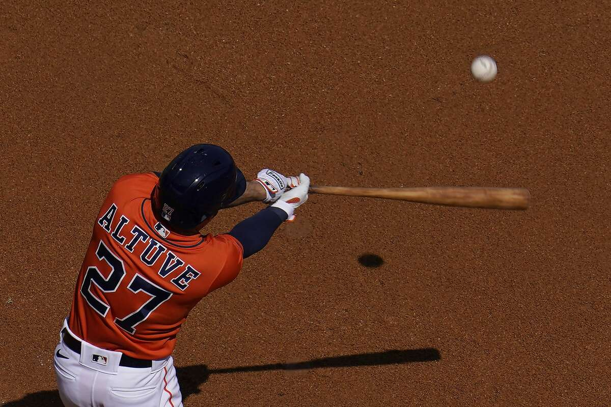 Houston Astros' Jose Altuve hits a solo home run against the Oakland Athletics during the first inning of Game 3 of a baseball American League Division Series in Los Angeles, Wednesday, Oct. 7, 2020.