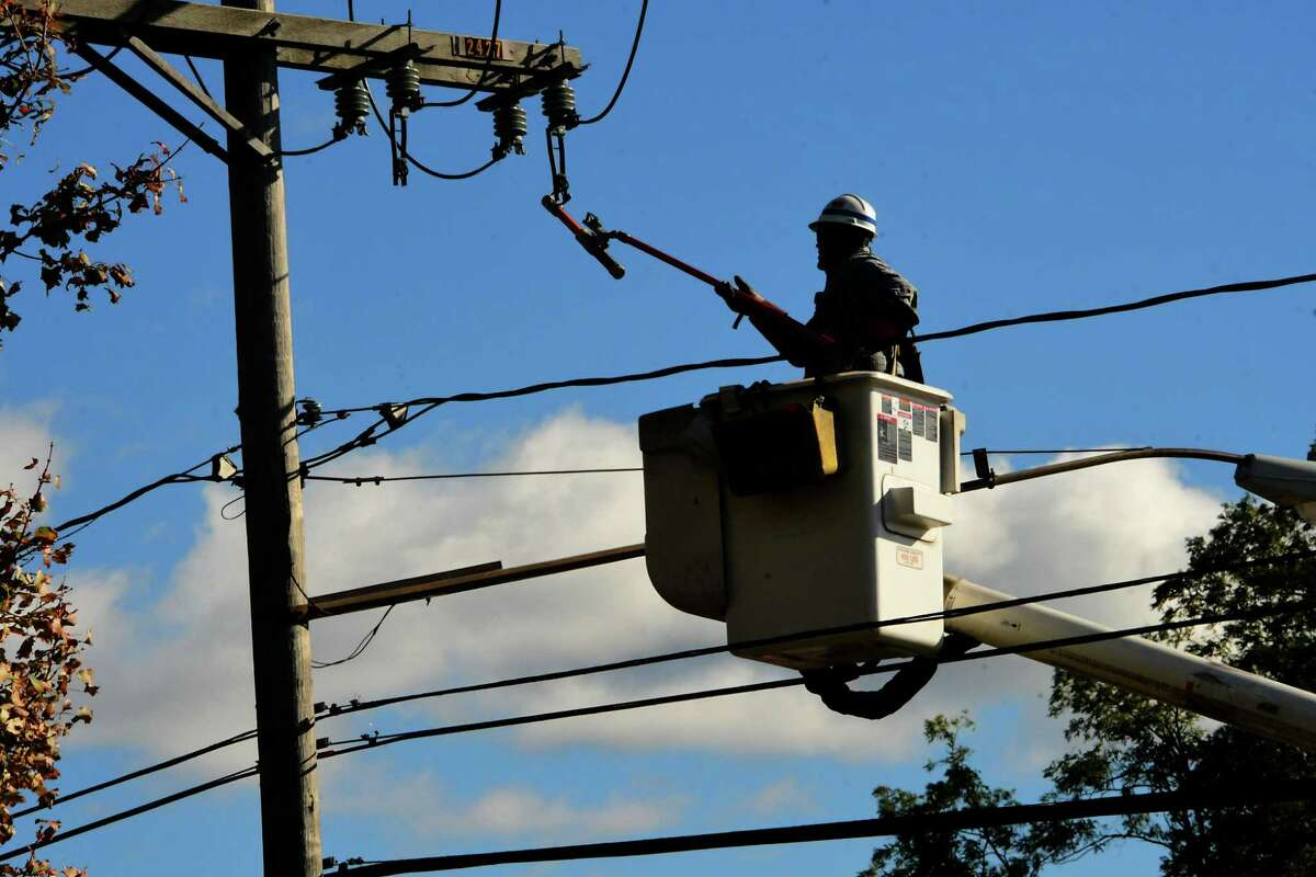 A National Grid lineman is seen working on a power line along Western Ave. in front of Hannaford on Thursday, Oct. 8, 2020 in Guilderland, N.Y. Wind and rain from a storm yesterday caused major damage and outages in this area as well as most of the Capital District. (Lori Van Buren/Times Union)