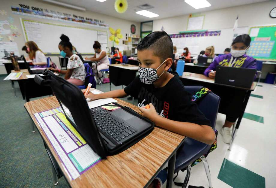 Fifth grader Aden Rodriguez uses his laptop to work on math at William Loyd Meador Elementary School, Thursday, Sept. 10, 2020, in Willis. Students at Willis ISD returned to in-person school on Tuesday, Sept. 8. Photo: Jason Fochtman, Houston Chronicle / Staff Photographer / 2020 © Houston Chronicle
