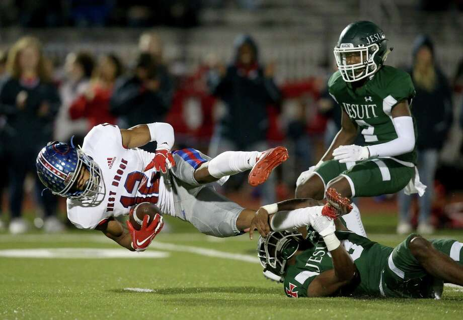 West Brook Bruins  wide receiver Thaddeaus Johnson (12) is tackled by  Strake Jesuit Crusaders safety Denzel Blackwell (3) in the first quarter of high school playoff football game on November 22, 2019 at Challenger Stadium in Waller, TX. Photo: Thomas B. Shea, Houston Chronicle / Contributor / © 2019 Thomas B. Shea / Houston Chronicle / Contributor