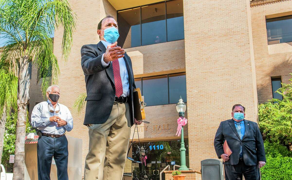 Poncho Casso and members of watchdog groups gather outside of Laredo City Hall, Wednesday, Oct. 7, 2020, to encourage Laredoans to vote against proposed amendments for the city's charter.