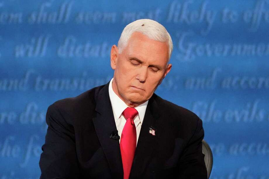 Vice President Mike Pence listens to Democratic vice presidential candidate Sen. Kamala Harris, D-Calif., during the vice presidential debate Oct. 7 in Salt Lake City. He paid no attention to the fly that was on his hair for 2 minutes and 3 seconds. Photo: Julio Cortez / Associated Press / Copyright 2020 The Associated Press. All rights reserved.