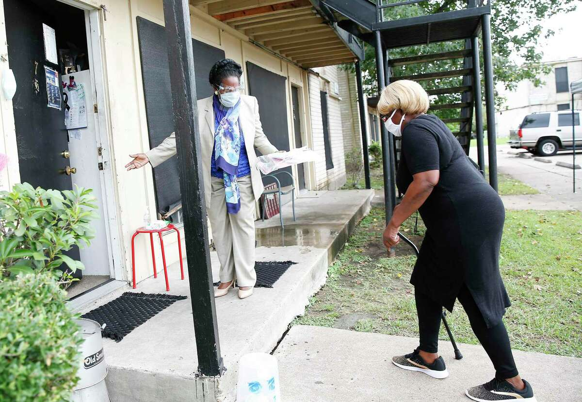 U.S. Rep. Sheila Jackson Lee talks with Judy Phillips after helping her avoid eviction from her Houston Apartment last month. But long-term policy fixes are needed.